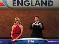 Charlize Theron and FIFA general secretary Jerome Valcke draw England during the FIFA Final Draw for the FIFA World Cup 2010 South Africa held at the Cape Town International Convention Centre (CTICC) on December 4, 2009.