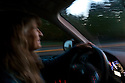 WA11370-00...WASHINGTON - Vicky Spring driving a car. (MR# S1)
