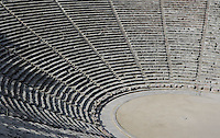 EPIDAURUS, GREECE - APRIL 15 : A detail of the Cavea of the Theatre, on April 15, 2007 in Epidaurus, Greece. The Theatre, designed by Polykleitos the Younger, was built in the late 4th century BC and extended in the Hellenistic period. It was rediscovered in 1881 and significantly restored in the 1950s.  It has the three main features of a Greek theatre: the orchestra, a sunken round stage; the skene, a raised rectangular stage beyond the orchestra; and the cavea, a raked semi-circular auditorium with radiating diazomas. The theatre is renowned for its accoustics thanks to the symmetry of the cavea, seen here in the morning light. (Photo by Manuel Cohen)