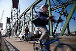 The Hawthorne Bridge spans the Willamette River in Portland, Oregon joining Hawthorne Boulevard and Madison Street.  It is the oldest vertical lift bridge in operation in the United States.  It is also the busiest bicycle and transit bridge in Oregon with over 4800 cyclists and 750 TriMet buses daily.