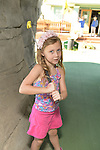 Freeport, New York, U.S. September 6, 2013. GABRIELLA BURKE, 5, from Valley Stream, plays miniature golf at Crow's Nest Mini Golf at the Nautical Mile.