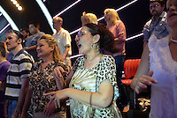 "Members of the studio audience sing along to their favorite stars turbofolk hits on the set of ""Zvezde Granda,"" or ""Grand Stars,"" a premier turbofolk showcase on Serbian television station TV Prva, in Belgrade, Serbia on July 1, 2015.  Members of the studio audience are paid 500 dinars, approximately $5, a day for their role and participation in the tapings which last for hours."