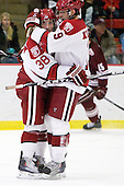 Conor Morrison (Harvard - 38) and Alex Killorn (Harvard - 19) celebrate Morrison's empty-net goal which made it 5-2 late in the third period. - The Harvard University Crimson defeated the visiting Colgate University Raiders 6-2 (2 EN) on Friday, January 28, 2011, at Bright Hockey Center in Cambridge, Massachusetts.