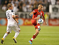 CARSON, CA – June 3, 2011: DC United midfielder Fred (27) intercepts the pass intended for LA Galaxy Chris Birchall (8) during the match between LA Galaxy and DC United at the Home Depot Center in Carson, California. Final score LA Galaxy 0, DC United 0.