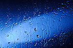 Wet blue glass with water droplets Abstract artistic background texture
