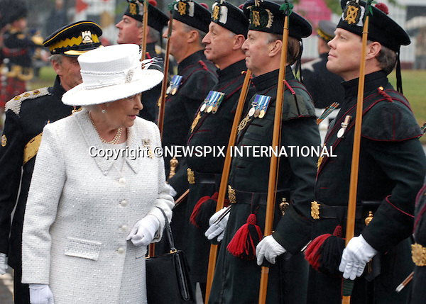 """QUEEN - """"Credit Crunch Protection"""".The Queen looks puzzled - she is probably thinking how in the hell will these men protect her with what looks very much like """"Pool Cues"""".Her Majesty visited the Royal Scots Dragoon Guards in Redford Barracks, Edinburgh on Armed Forces Day . The Queen is the  regiment's Colonel-in-Chief. The Regiment is providing Her Majesty's Royal Guard at Holyrood Palace for Royal Week this week_27/6/09.Photo Credit: ©M Owens_Newspix International..**ALL FEES PAYABLE TO: """"NEWSPIX INTERNATIONAL""""**..PHOTO CREDIT MANDATORY!!: NEWSPIX INTERNATIONAL..IMMEDIATE CONFIRMATION OF USAGE REQUIRED:.Newspix International, 31 Chinnery Hill, Bishop's Stortford, ENGLAND CM23 3PS.Tel:+441279 324672  ; Fax: +441279656877.Mobile:  0777568 1153.e-mail: info@newspixinternational.co.uk"""