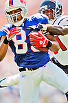 11 September 2005: Lee Evans, wide receiver for the Buffalo Bills, receives a pass in a game against the Houston Texans on September 11, 2005.  The Bills, wearing their 60s throwback uniforms, defeated the Texans 22-7, winning their first game of the season at Ralph Wilson Stadium in Orchard Park, NY.<br />