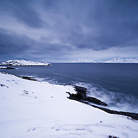 Rugged winter coastline near Henningsvær, Austvågøy, Lofoten islands, Norway
