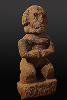 Tiki statue in volcanic tuff, a protective statue representing Ti'i, a half-human half-god ancestor who is believed to be the first man, from Raivavae in the Austral Islands, in the Musee de Tahiti et des Iles, or Te Fare Manaha, at Punaauia, on the island of Tahiti, in the Windward Islands, Society Islands, French Polynesia. The Museum of Tahiti and the Islands was opened in 1974 and displays collections of nature and anthropology, habitations and artefacts, social and religious life and the history of French Polynesia. Picture by Manuel Cohen