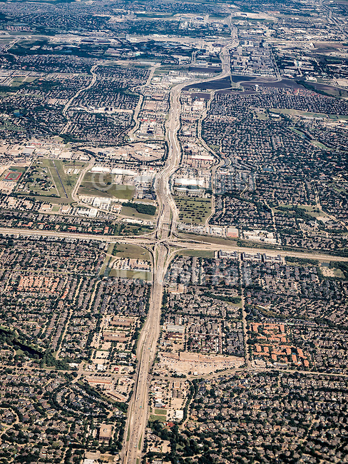 Freeway interchange and suburban homes. Dallas-Ft. Worth metroplex from a window seat flying to Pittsburgh, Penn.