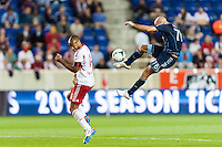 Thierry Henry (14) of the New York Red Bulls reacts as Aurelien Collin (78) of Sporting Kansas City clears a ball. Sporting Kansas City defeated the New York Red Bulls 1-0 during a Major League Soccer (MLS) match at Red Bull Arena in Harrison, NJ, on April 17, 2013.