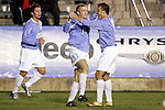 11 November 2005: North Carolina's Ben Hunter (11) accepts congratulations from his teammates for the first of his two goals, scored in the 55th minute. The University of North Carolina defeated Clemson University 2-0 at SAS Stadium in Cary, North Carolina in a semifinal of the 2005 ACC Men's Soccer Championship.