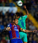 Levante's Sergio Ballesteros (L) vies for the ball with FC Barcelona's Thiago Alcantara (R) during the Spanish league football match Levante UD vs FC Barcelona on April 14, 2012 at the Ciudad de Valencia Stadium in Valencia. (Photo by Xaume Olleros/Action Plus)