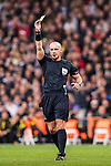 Referee Szymon Marciniak shows the yellow card during the 2016-17 UEFA Champions League match between Real Madrid and Borussia Dortmund at the Santiago Bernabeu Stadium on 07 December 2016 in Madrid, Spain. Photo by Diego Gonzalez Souto / Power Sport Images