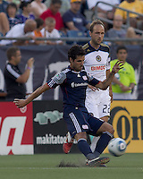 New England Revolution midfielder Benny Feilhaber (22) passes the ball. In a Major League Soccer (MLS) match, the Philadelphia Union defeated the New England Revolution, 3-0, at Gillette Stadium on July 17, 2011.