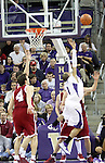 Klay Thompson (arms still raised) gets called for his 4th foul as UW's Venoy Overton (#1) drives towards the basket during a critical part of the 2nd half during the Cougars Pac-10 conference showdown with the University of Washington on March 7, 2009, in Seattle, Washington.  Both teams came in to the game on a roll, and in a hard fought battle, the Huskies prevailed 67-60 to wrap up the regular season Pac-10 championship.
