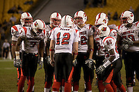 Louisville Cardinals quarterback Brian Brohm (12) calls a play in the huddle.  The Louisville Cardinals defeated the Pitt Panthers 48-24 on November 25, 2006 at Heinz Field, Pittsburgh, Pennsylvania.
