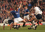 Seb Rozental is tackled by Dundee, March 2000