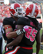 Wide receiver Steven Howard is congratulated by Quintin Payton after scoring a touchdown. NC State defeated Central Michigan 38-24 on Saturday, October 8, 2011 at Carter-Finley Stadium in Raleigh. Photo by Al Drago.