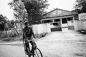 Sri Lankan Government health centre is seen against the Sri Lankan army soldier patrolling in Punaineeravi village in Kilinochchi in Northern Sri Lanka. Photo: Sanjit Das/Panos