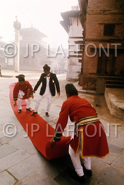 February 24th, 1975. Kathmandu. Nepal. The Coronation of King Birendra and Queen Aishwarya of Nepal, on the chosen day. At 8:37 a.m., the precise moment selected by court astrologers more than a year before, the royal priest placed the huge jewel-encrusted crown on the King's head and a diamond tiara atop Queen Aishwarya's. They were both massacred by their son Dipendra  on 1 June 2001. Preparation for the coronation.