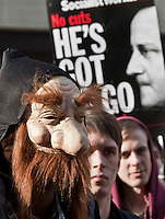 Protester - 2012<br /> <br /> London, 14/03/2012. NUS (National Union of Students) organised a demonstration against the coalition government reforms of the higher education system. Hundreds of people gathered outside ULU (University of London Union) in Malet Street and marched to Central London. The rally was peaceful and ended outside the Department of Business, Innovation and Skills in Victoria Street, Westminster. Adding a new colour at the London's sunny day was the brand new &quot;liaison officers&quot; of the MET. A new team of police officers, wearing light blue vests, created specifically to improve dialogue between police and protesters.