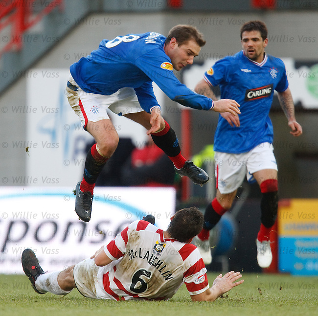 Mark McLaughlin lunges in on Rangers midfielder Kevin Thomson