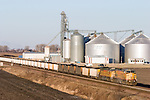 An eastbound loaded Union Pacific coal train passes the giant grain elevator complex at Elburn, IL early one winter morning.