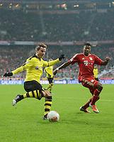 FUSSBALL   1. BUNDESLIGA  SAISON 2012/2013   15. Spieltag FC Bayern Muenchen - Borussia Dortmund     01.12.2012 Mario Goetze (li, Borussia Dortmund)gegen David Alaba (re, FC Bayern Muenchen)