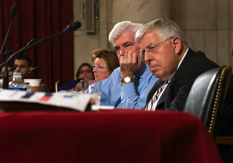 WASHINGTON, DC - June 17: Sen. Christopher J. Dodd, D-Conn., sitting in for ailing Chairman Edward M. Kennedy, D-Mass., and ranking member Michael B. Enzi, R-Wyo., during the first day of the Senate Health, Education, Labor and Pensions markup of comprehensive healthcare legislation. Sen. Barbara Mikulski, D-Md., is in background. (Photo by Scott J. Ferrell/Congressional Quarterly)