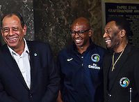 Brazilian soccer legend Pele, center, New York Cosmos midfielder Marcos Senna, former teammate Carlos Alberto pose for photographs at the Empire State Building in New York August 01, 2013 by Kena Betancur / VIEWpress