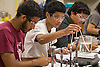 Students perform an experiment during class, May 30, 2013 at Reagan High School.