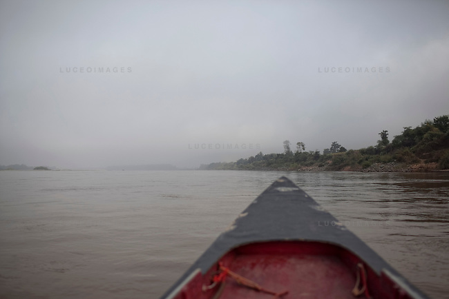 Laos beach front, right, on the Mekong River downstream from Sop Ruak, Thailand. Photo taken on Thursday, December 10, 2009. Kevin German / Luceo Images