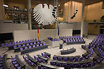 The Plenary Chamber in the centre of the old Reichstag building in central Berlin, Germany. The Bundestag is a legislative body in Germany. The new Reichstag building was officially opened on 19 April 1999. At least 598 Members of the Bundestag are elected and meet here.