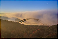 Taken from a lookout above Pennybacker Bridge on an early morning, the fog enveloped Pennybacker Bridge entirely for a good portion of the early morning hours. Eventually, the Austin bridge began to show though the vanishing fog, leaving clear blue skies and a rising moon.