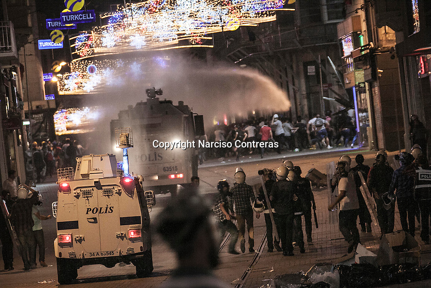 In this Saturday, Jun. 15, 2013 photo, clashes sparked out on Istiklal street after the anti-riot police attacked a peaceful rally in Gezi park of Taksim Square during the ongoing turmoil in Istanbul, Turkey. (Photo/Narciso Contreras).
