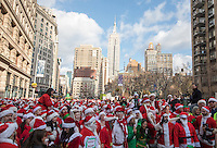 NEW YORK, NY - December 10: Revelers dressed as Santa Claus gather near to the Flat Iron building during the annual SantaCon event in New York City December 10,2016. VIEWpress/Maite H. Mateo
