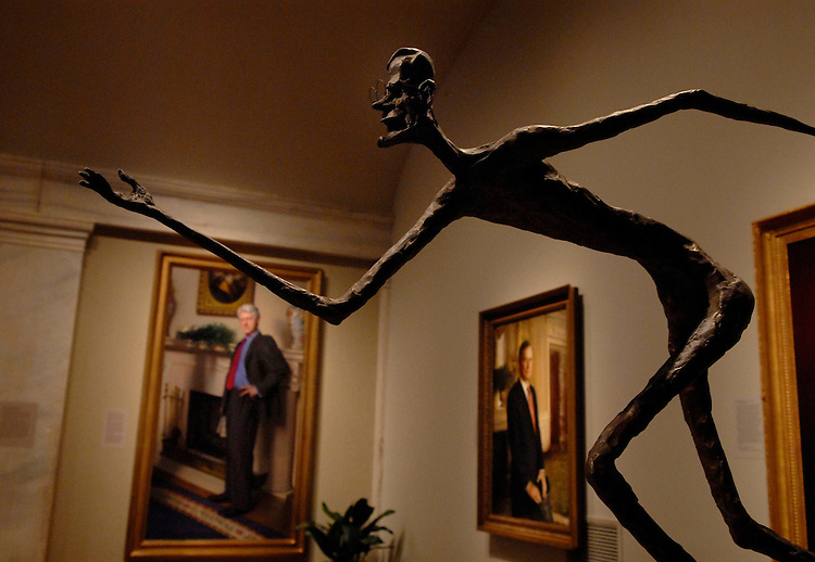 A bronze sculpture of President George H.W. Bush playing horseshoes by Pat Oliphant, appears in the Smithsonian American Art Museum and National Portrait Gallery.  The two museums are collectively known as the Donald W. Reynolds Center for American Art and Portraiture.  Paintings of the Bush and Bill Clinton appear in the background.