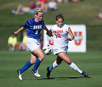Caroline Miller (10) of Virginia fights for the ball with Libby Jandl (3) of Duke during the game at Klockner Stadium in Charlottesville, VA.  Virginia defeated Duke, 1-0.