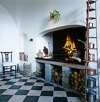 The original kitchen is in the process of being restored and has a vaulted ceiling and black and white marble floor