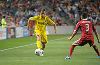 Columbus midfielder Chris Birchall (8) makes a pass while being defended by Chicago defender Dan Gargan (3).  The Chicago Fire defeated the Columbus Crew 2-1 at Toyota Park in Bridgeview, IL on June 23, 2012.