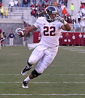 Nov 27, 2010; Charlottesville, VA, USA; Virginia Cavaliers running back Keith Payne (22) runs the ball for a 4th quarter touchdown against Virginia Tech during the game at Lane Stadium. Virginia Tech won 37-7. Mandatory Credit: Andrew Shurtleff