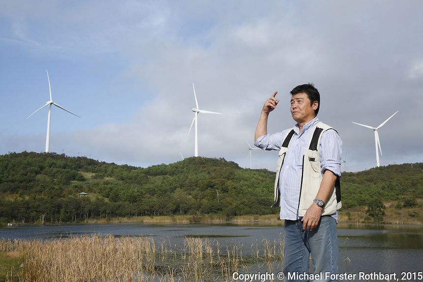 Takaaki Ide, a farmer and former evacuee who has returned home to Kawauchi, Fukushima. <br /> <br /> In March 2011, an earthquake and tsunami hit northern Japan and destroyed the Fukushima Daiichi nuclear power plant. Some 488 thousand people evacuated from the three-part disaster; in 2015, nearly 25% remain displaced.<br /> <br /> A massive effort is now underway to decontaminate towns in the Fukushima Exclusion Zone. Thousands of laborers are cleaning or demolishing every building, and removing and incinerating all topsoil in inhabited areas. In the adjacent forests and mountains, radiation levels remain higher and will not be cleaned.<br /> <br /> Naraha, 12 miles south of the nuclear plant, is the first town to reopen after the disaster. Residents were allowed to return home full-time on Sept. 5, 2015. To date, an estimated 100 residents have returned, out of a pre-disaster population of 7,400. <br /> <br /> I returned to Fukushima one week after Naraha reopened and spent a month there, interviewing and photographing returnees and decontamination workers. I asked portrait subjects to write down their hopes and fears for their hometowns, and then discuss these thoughts about their future. People&rsquo;s written declarations often differed substantially from their spoken comments.<br /> <br /> &copy; Michael Forster Rothbart Photography<br /> www.mfrphoto.com &bull; 607-267-4893<br /> 34 Spruce St, Oneonta, NY 13820<br /> 86 Three Mile Pond Rd, Vassalboro, ME 04989<br /> info@mfrphoto.com<br /> Photo by: Michael Forster Rothbart<br /> Date:  9/23/2015<br /> File#:  Canon &mdash; Canon EOS 5D Mark III digital camera frame B15843