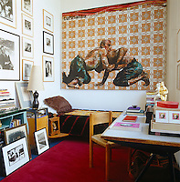 The guest bedroom features a desk by Jean Prouve and a painting by Jean-Baptiste Mondino