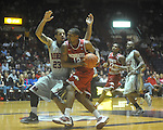 "Arkansas' Marcus Britt (12) is fouled by Mississippi guard Trevor Gaskins (23)  at C.M. ""Tad"" Smith in Oxford, Miss. on Saturday, March 5, 2010. (AP Photo/Oxford Eagle, Bruce Newman)"