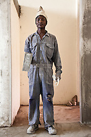 A plasterer at work in Nairobi. He is part of a construction crew working to finish The Greenhouse, a retail and office development.