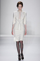 Model walks runway in an ivory wool boucle princess skirt suit seamed w/mink-chain-mink stole, from the Zang Toi Fall 2012 &quot;Glamour At Gstaad&quot; collection, during Mercedes-Benz Fashion Week New York Fall 2012 at Lincoln Center.