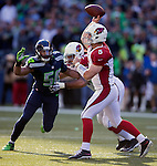 Arizona Cardinals quarterback Drew Stanton (5) passes against the Seattle Seahawks  linebacker K.J. Wright (50) as Cardinals guard Paul Fanaika (74) provides blocking at CenturyLink Field in Seattle, Washington on November 23, 2014. Stanton completed 14 of 26 passes for 149 yards and had one interception in the Cardinals 3-19 loss to the Seahawks. ©2014. Jim Bryant Photo. All Rights Reserved.