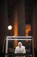 Pope Benedict XVI prays in front of the nativity crib in Saint Peter's Square after celebrating the Vespers and Te Deum prayers in Saint Peter's Basilica at the Vatican on December 31, 2012.