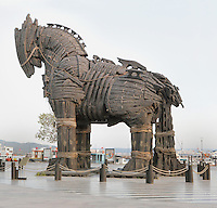 Model of the Trojan horse from the 2004 film Troy, directed by Wolfgang Petersen, preserved on the seafront at Canakkale, Turkey. Canakkale is on the southern (Asian) coast of the Dardanelles and is the nearest city to the archaeological site of Troy. The original Trojan horse was said to be used by the Greeks to capture the city of Troy from the Trojans during the Trojan War. Greek soldiers hid inside the body of the horse which was pulled into the besieged city by the Trojans, who believed the Greeks to have retreated. Picture by Manuel Cohen